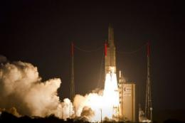 An Ariane 5 rocket takes off, on its way to place two communications satellites into geostationary orbit