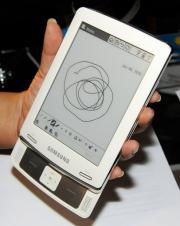 An attendee examines the new E6 e-book reader by Samsung
