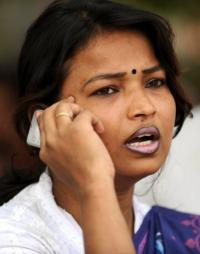 An Indian woman speaks on a cellullar telephone in Allahabad