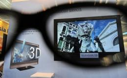 A picture of a 3D television is seen through 3D glasses