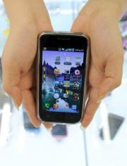 A shop manager shows Samsung Electronics' popular Galaxy S mobile phone, a competitor to Apple's new iPhone4