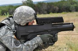 A soldier aims an XM25 weapon system at Aberdeen Test Center, Maryland