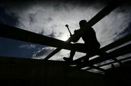 A soldier builds a provisional dwelling for people displaced by February 27th's earthquake in 2010