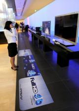 A South Korean woman watches a 3D TV