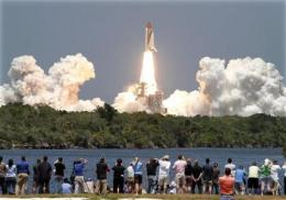 Astronauts forced into shorter shuttle survey (AP)