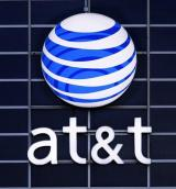 AT&T adds record number of iPhones, posts tax gain