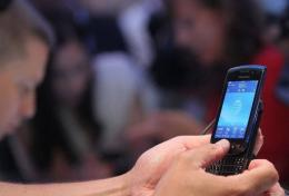 A user tries out the new Blackberry Torch 9800 smartphone
