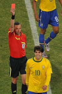 Brazil's midfielder Kaka reacts as he is sent off by French referee Stephane Lannoy (back)