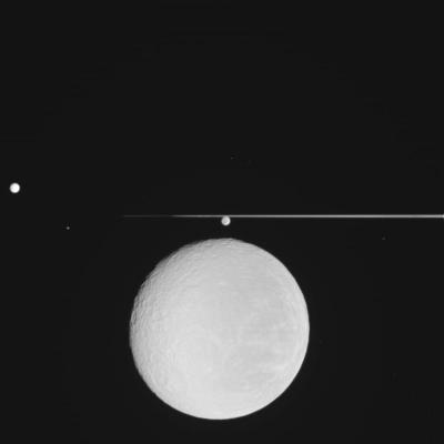 Cassini captures Rhea coming down