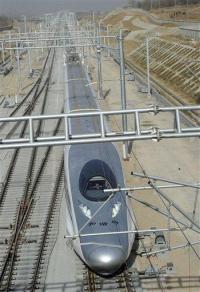 China passenger train hits 300 mph, breaks record (AP)