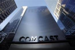 Comcast 4Q profit up on revenue boost, tax gain (AP)