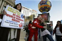 Embracing history: Man sets hugs record in Vegas (AP)