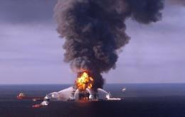Fiire boat response crews battle the blazing remnants of the offshore oil rig Deepwater Horizon