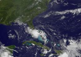 GOES-13 sees new Tropical Storm Bonnie raining on south Florida