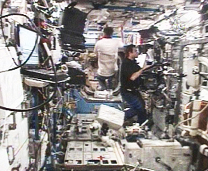 Chamitoff (right) works inside the International Space Station's Destiny