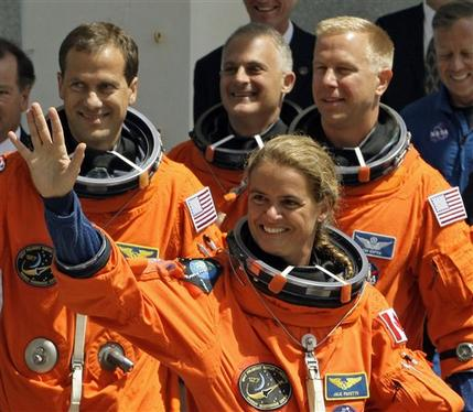 Astronauts board space shuttle for evening launch