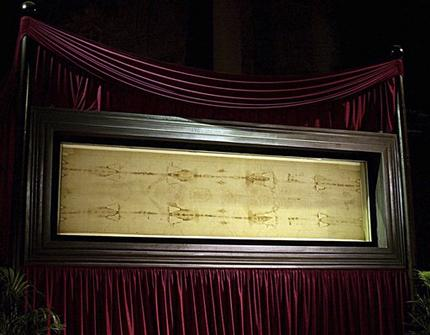 A Vatican researcher claims a nearly invisible text on the Shroud of Turin proves the authenticity of the artifact revered as Jesus' burial cloth.