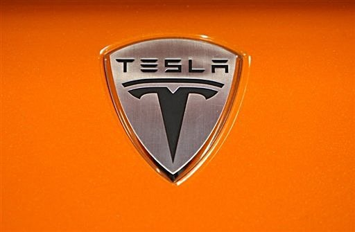 Tesla Motors Sedan. The Tesla Motors logo is seen