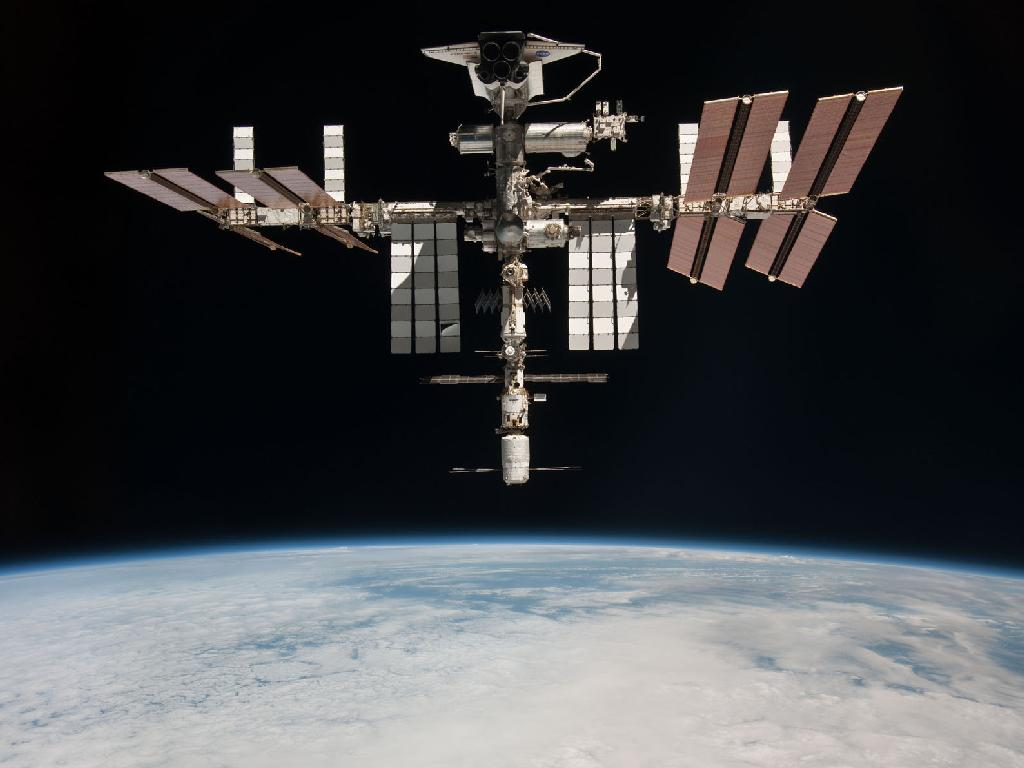 Nasa releases first photo of shuttle docked in space for Nasa press release