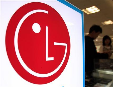 Clerk talks with customer near the lg electronics logo at an