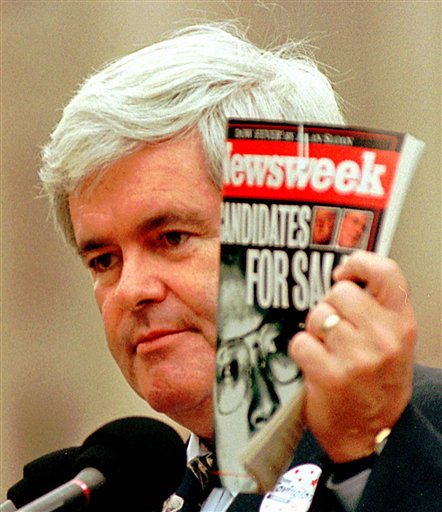 House speaker newt gingrich r ga holds a copy of newsweek magazine