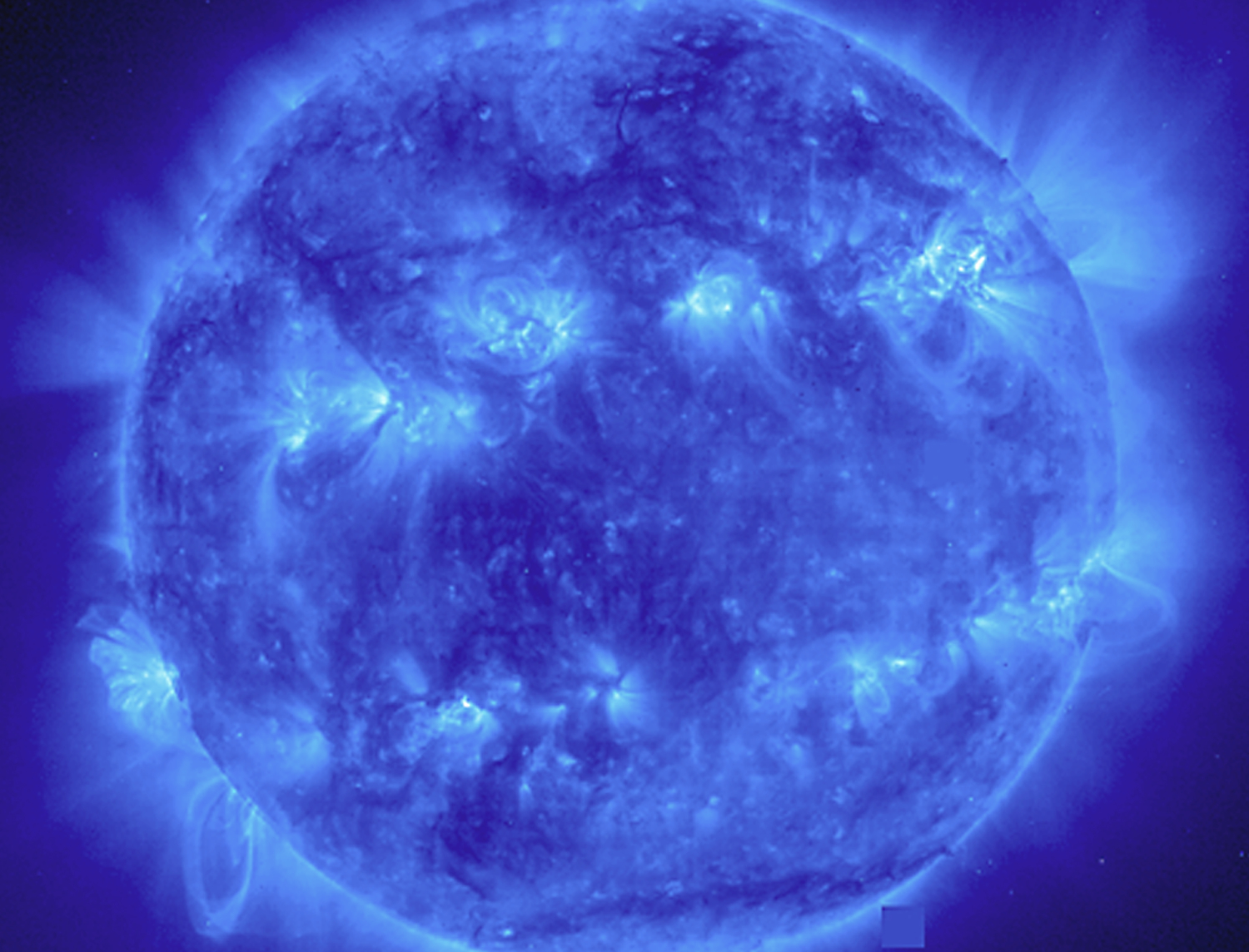 Image of solar activity shows two bright bands circling ...