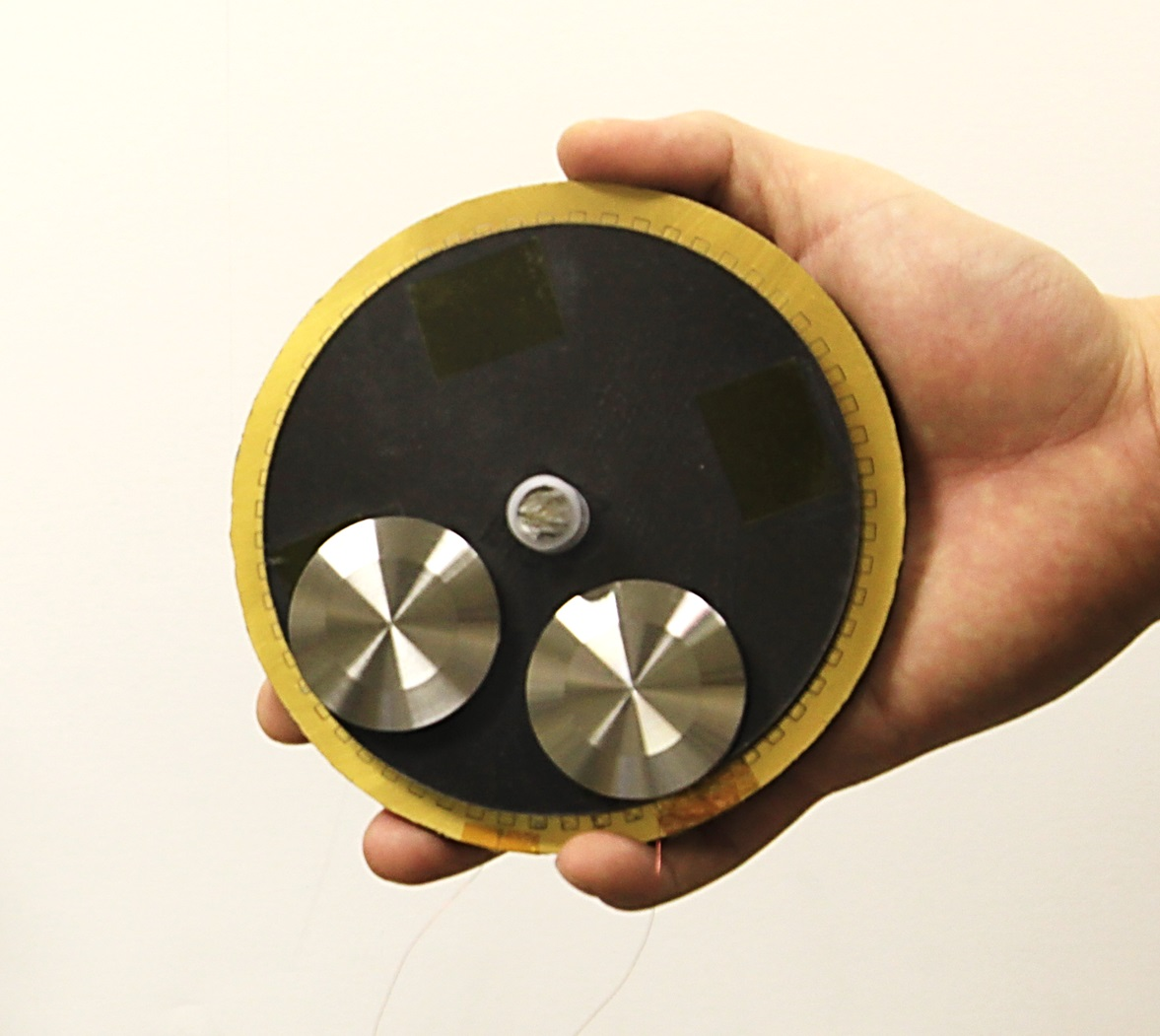 hand-held triboelectric generator for harvesting energy from human ...