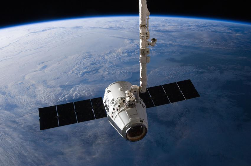 The SpaceX Dragon cargo craft is pictured just prior to being released ...