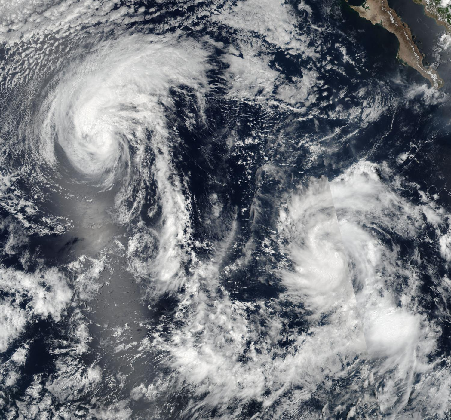 ... Tropical Storm Howard (left) and Tropical Depression Ivette (right) in