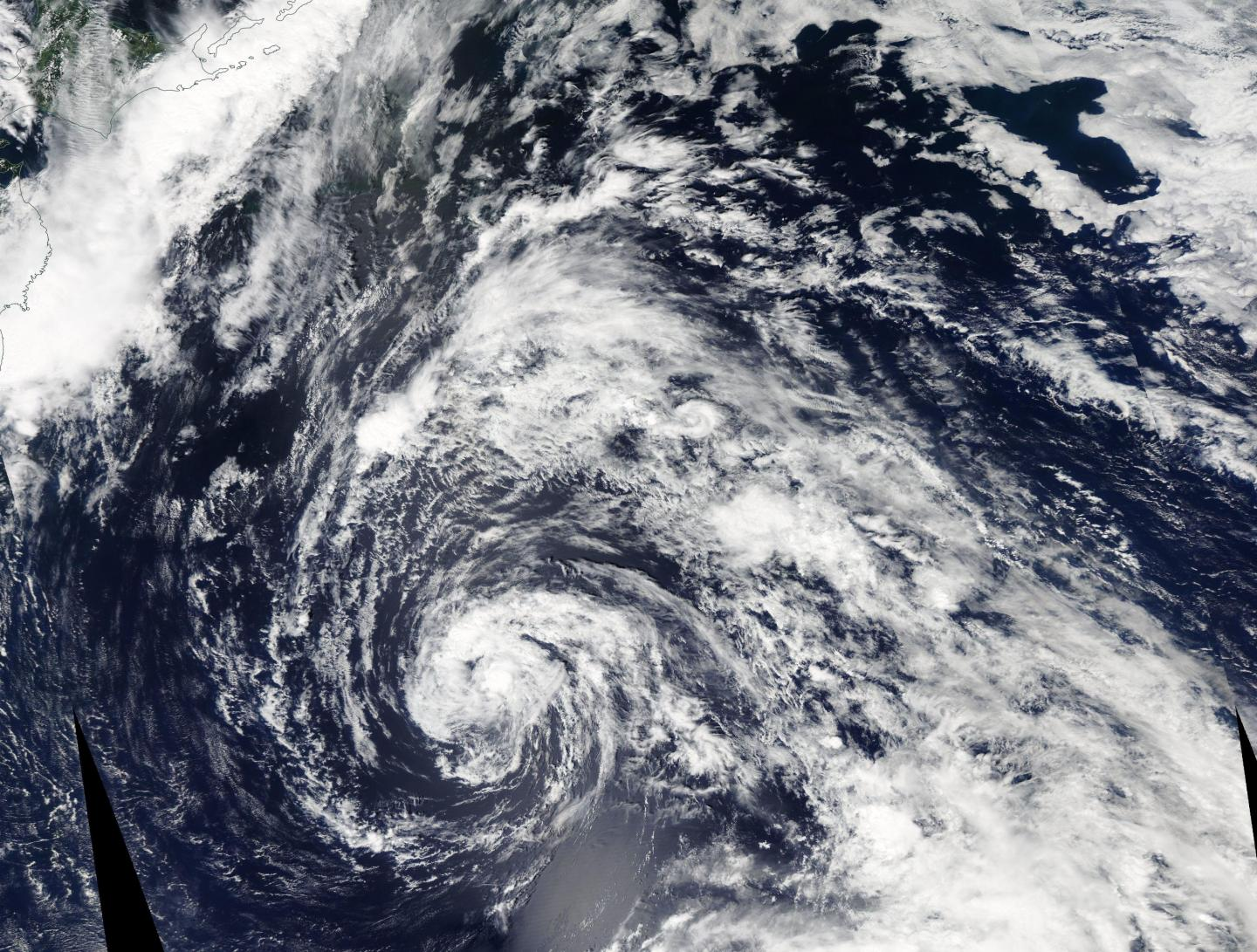 NASA sees Tropical Storm 12W over the open Northwestern Pacific Ocean