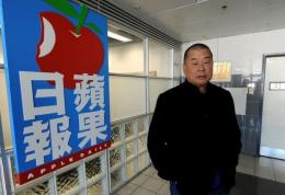 Hong Kong media tycoon Jimmy Lai poses outside his company's headquarters
