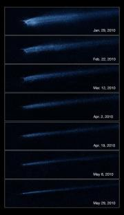 Hubble finds that a bizarre X-shaped intruder is linked to an unseen asteroid collision