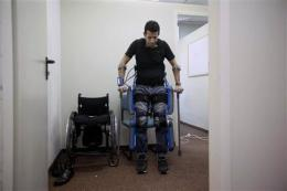 Israeli device lets paralyzed people stand, walk (AP)