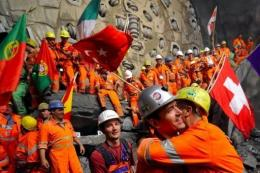 Miners celebrate after completing the world's longest tunnel beneath the Swiss Alps