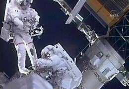 NASA astronauts Steve Bowen (L) and Mike Good during a spacewalk