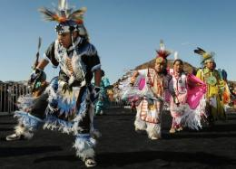 Native American children from the Red Hand Dance Troupe, perform on the newly opened bridge