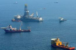 Offshore supply vessels assist and observe the worksite of the Deepwater Horizon oil rig explosion