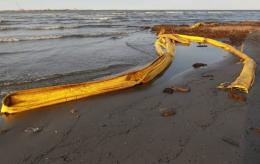 Oil booms are seen washed on to a beach as high winds and waves push the booms ashore in Louisiana