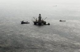 Oil sheen is seen with vessels assisting near the source of the BP Deepwater Horizon oil spill