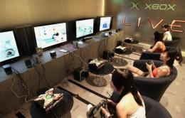 People play a multi-player video game during an introduction of