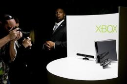 Photographers take pictures of the Kinect peripheral and the new Xbox 360 console
