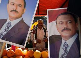 Pictures of Yemeni President Ali Abdullah Saleh decorate the stall of a juice vendor during a pro-regime protest