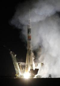 Rocket with US-Russian crew blasts off (AP)