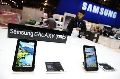 Samsung staff set up the display for the Samsung Galaxy Tab for the International Consumer Electronics Show in Las Vegas