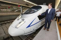 Schwarzenegger checks out China's high-speed rail (AP)