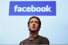 SEC rule likely to trigger Facebook IPO in 2012 (AP)