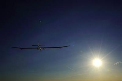 Solar plane lands after completing 24-hour flight (AP)