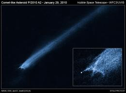 Suspected Asteroid Collision Leaves Odd X-Pattern of Trailing Debris
