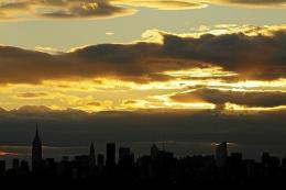 The sun sets over the Manhattan skyline