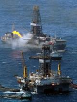 Transocean Development Driller III (R) and the Discoverer Enterprise drilling rig continue efforts to recover oil